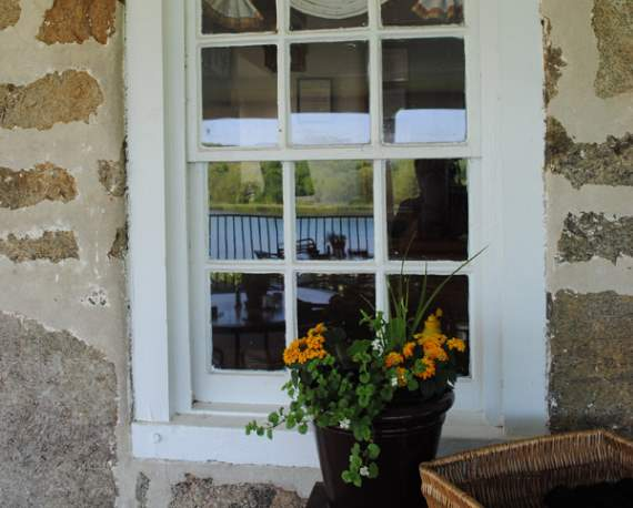 Stone wall with flowers in front of a window